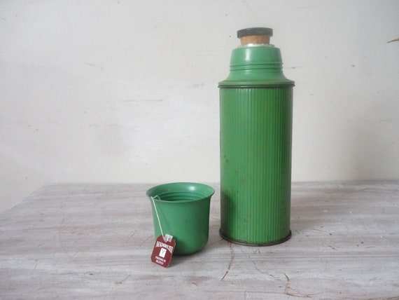 Old thermos in vintage green  kitchenalia/ props/ rustic vase
