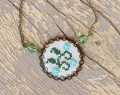Woodland necklace with hand embroidered branch in bronze - n048