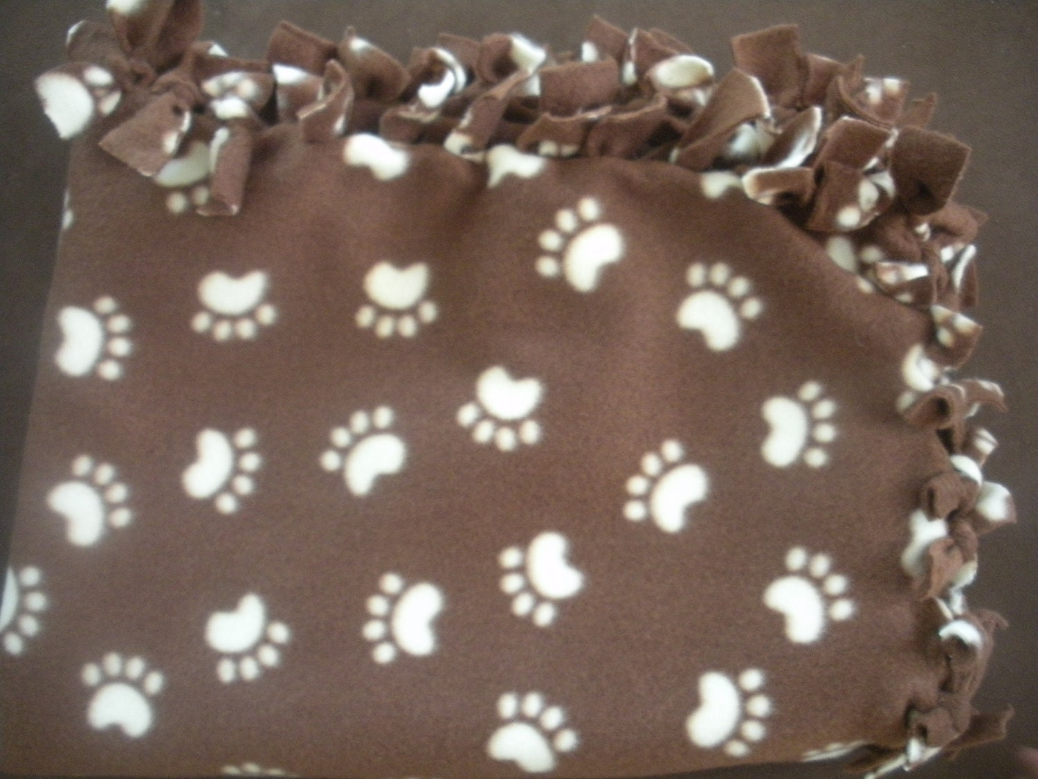 Paw Prints Dog Blanket Brown And Creme Colored Blanket