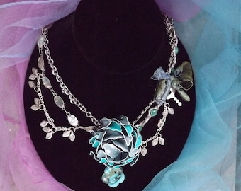 THE SECRET GARDEN, Repurposed Vintage Jewelry necklace, created with repurposed jewelry of flowers, leaves and a tiny key