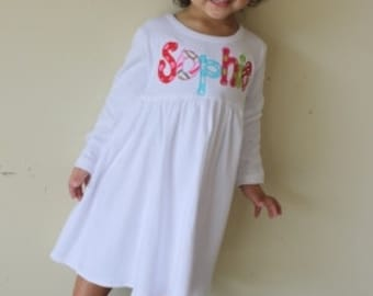 White empire waist dress with name applique