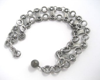 Chained link and roller bracelet