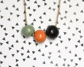 Ceramic bead necklace .  Handmade ceramic bead / Pale green, orange and black - oelwein