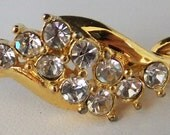 Vintage jewelry bracelet in gold tone with clear prong set rhinestones bangle bracelet
