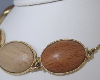 Vintage jewelry necklace by Amerique in faux wood ovals set in gold tone with fish hook clasp and hang tag Sale half off
