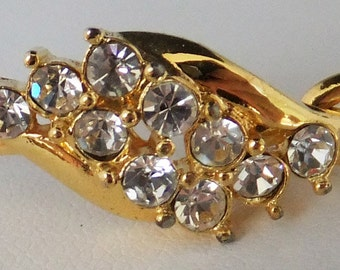 Vintage jewelry bracelet in gold tone with clear prong set rhinestones bangle bracelet
