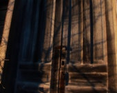 Old weathered abandoned church door in shadows color print