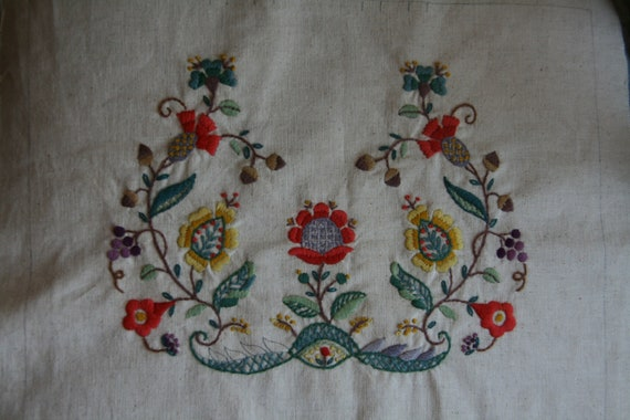 Crewel embroidery piece with bright harvest colors