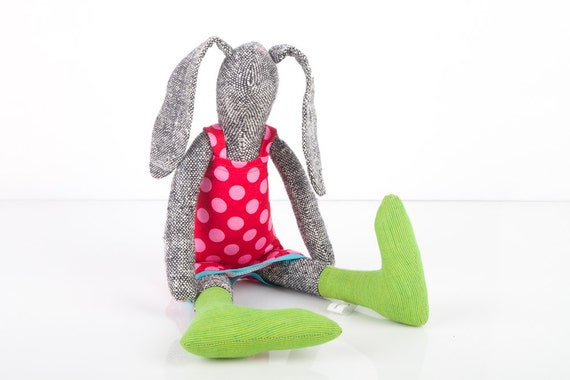 Black and white rabbit made from knitted pure silk , wearing  red dress dotted pink and Striped green socks , handmade fabric doll