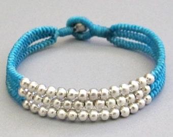 Multi Line Silver Colour Bead Blue Wax Cord Snake Knot Bracelet