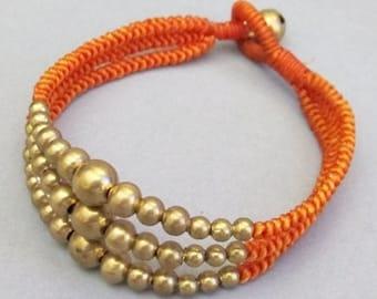 Multi Strand Brass Bead Orange Wax Cord Snake Knot Bracelet