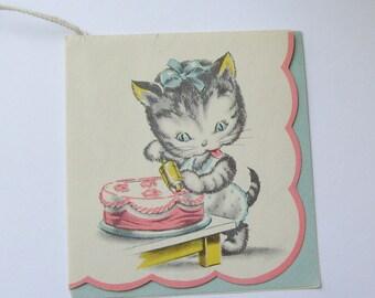 Vintage bridge tally card kitten decorating a birthday cake ephemera booklet style