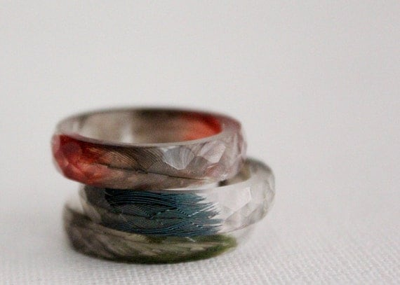 thin multifaceted eco resin ring with blue macaw feathers - size 8