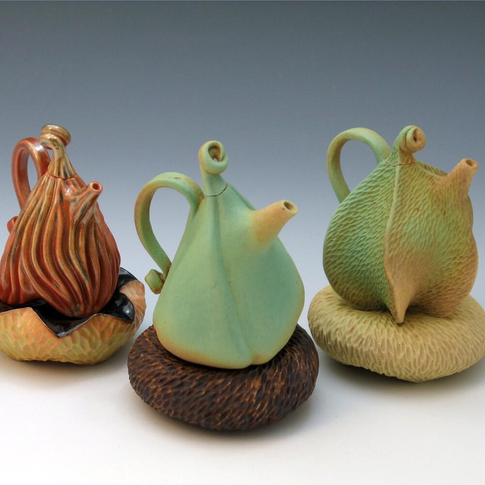 Puffy Green Porcelain Teapot On Brown Pillow