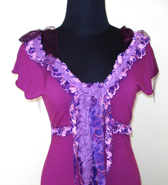 a vibrant violet sassy sexy bohemian gypsy gothic dress with heavily embroidered trim...