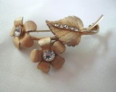 Vintage 1950s BSK signed floral Goldtone and Rhinestone Crystal Flower Brooch Pin