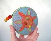 Circus Clown circular ornamented zipper pouch in light blue orange yellow colours