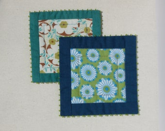 Playful spring coasters in green and blue flower prints, patchwork mug rugs