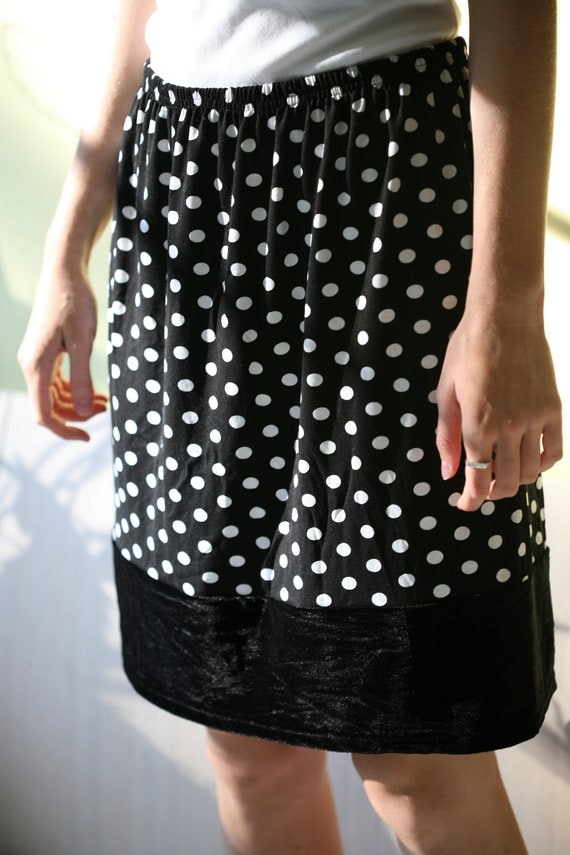 If you're wearing a black and white polka dot blouse, pair it with a black pencil skirt and heels for a simple, polished look that's ideal for the office. If the star of your outfit is a black and white polka dot skirt, wear it with a white T-shirt or tank for a casual look.