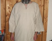 T tunic style, thigh length shirt of Osnaburg cotton.
