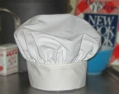 Child's adjustable chef hat. Fits ages 1 to 7. Classic white. Great for cooking, pretend play, dress up, photo prop, gift