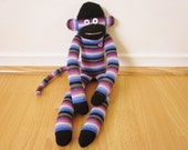 Blueberry yogurt sock monkey doll - blue, purple, white, and pink stripes with rhinestone heart