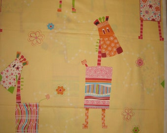 Large giraffes on light yellow fabric Imported from Asia 1 yard 30""