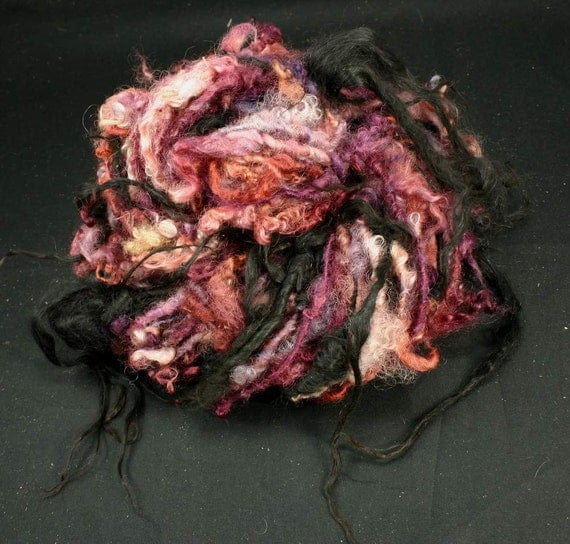 Handspun art yarn: Black and red, reserved for Margie