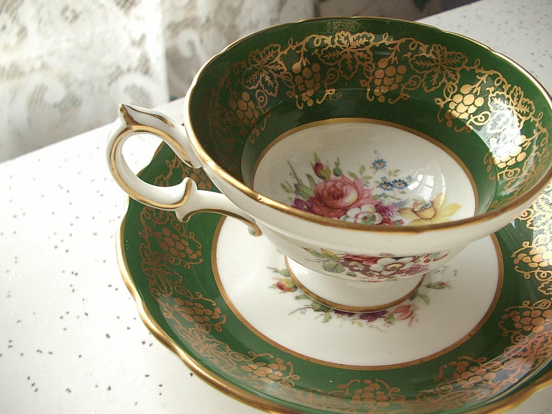 vintage green and gold tea cup and saucer set by shoponsherman. Black Bedroom Furniture Sets. Home Design Ideas