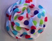 White and colorful polka dot head band headband and ribbon flower clip that is a match set.  green pink yellow purple blue turquoise dots