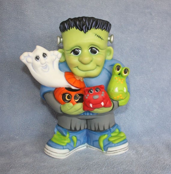 Handpainted Ceramic Frankenstein Jr and all of his little Monster Friends