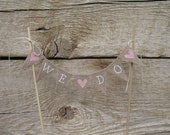 We Do Baker Banner Wedding cake topper in tea dyed cotton and pink hearts.