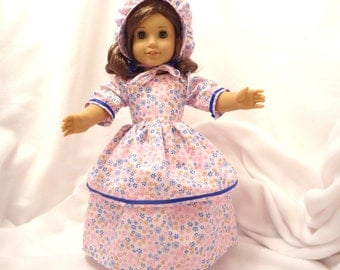 Pink, magenta, blue and gold print, long dress for 18 inch dolls, double-skirted, with blue ribbon trim.