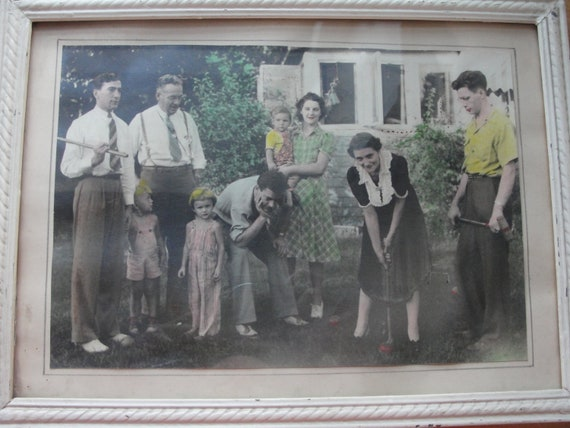 Vintage colorized photo in glass and painted, wood frame