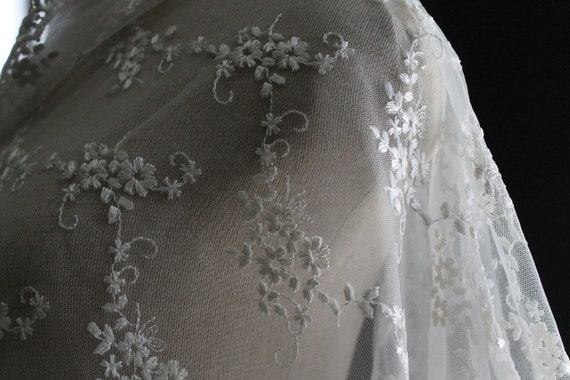 Ivory Bridal Netting Lace Fabric with Allover Embroidery with Scalloped Edges...  .