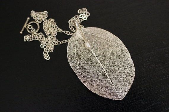 Real leaf with pearl necklace