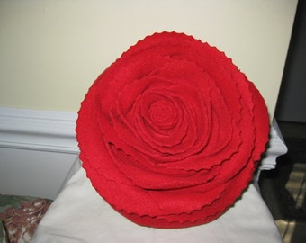 A Red Rose on an Sage Green Pillow
