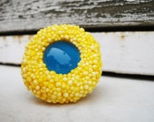yellow and blue polystyrene and glass adjustable unique ring
