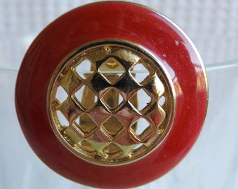 """Vintage stamped clip on earrings. Red rim, central gold toned grill, STAMPED with a butterfly sign. 1.23"""" ins across. SLVAL10.1-12.10-19.5"""
