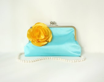Blue Clutch Purse with Yellow Flower Adornment