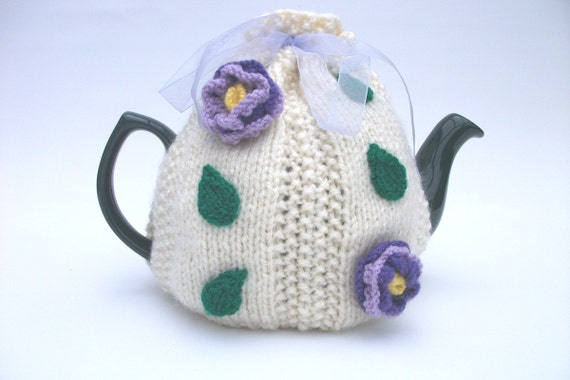 Cream teacosy with prple/lilac flowers