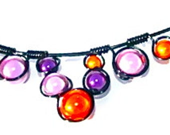 Orange and Purple Miracle Beads, Wrapped in Black Wire and adjustable black chain.