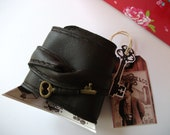 unisex brown soft faux leather vegan cuff with key