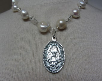 Virgencita Plis medal with Freshwater Pearls wire wrapped w/ clasp