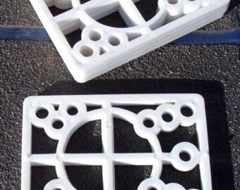 "Set of Risers For Skateboard Trucks Size 1/4"" hard plastic 1980s era Old School Multi Hole Pattern"