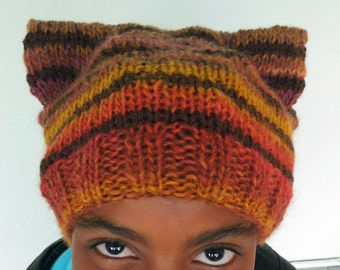 Hat is a warm wool acrylic blend, knit in rich autumnal hues
