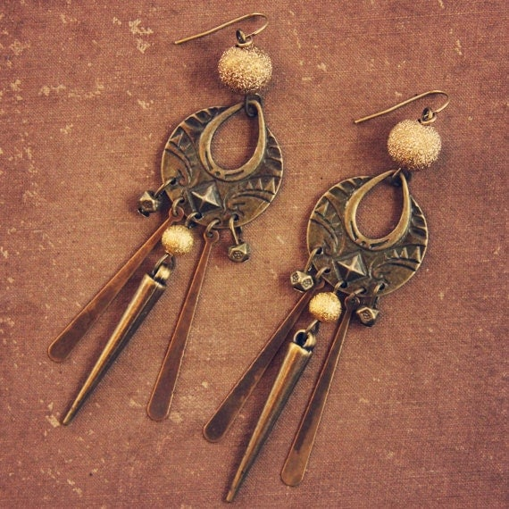 nevada.  a pair of gold and brass tribal earrings with a hint of sparkle.