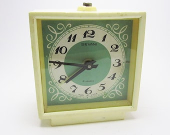 Beautiful VINTAGE WIND up CLOCK, use for home decor.