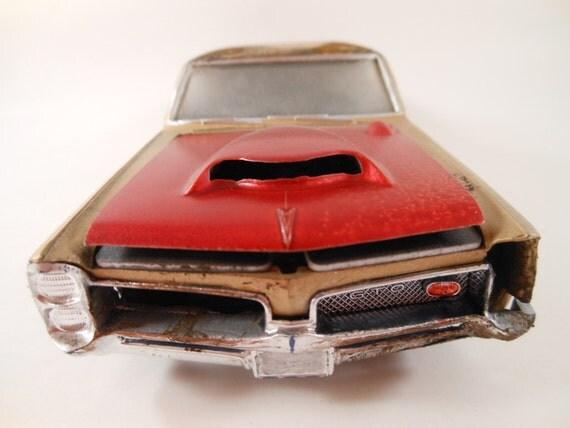 1967 Pontiac GTO 1/24 scale model car in gold