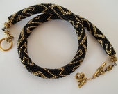 Black and gold bead crochet necklace. Dragon necklace. Made to order.